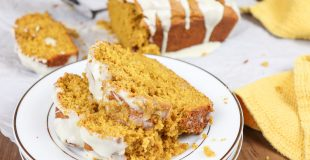 Pumpkin bread with maple cream icing is an easy pumpkin bread recipe. It's the perfect dessert for the fall season with plenty of cinnamon, nutmeg, ginger, and fall spices.