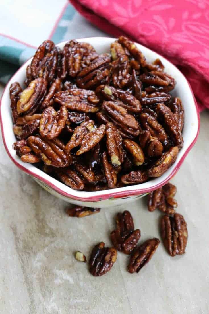 Easy Stovetop Candied Pecans is an easy recipe to make. The stovetop recipe only requires three ingredients and a few minutes. Candied pecans are the perfect gift for any occasion including Christmas. #pecans #candied #candiedpecans #dessert #easy #stovetop #best #brownsugar