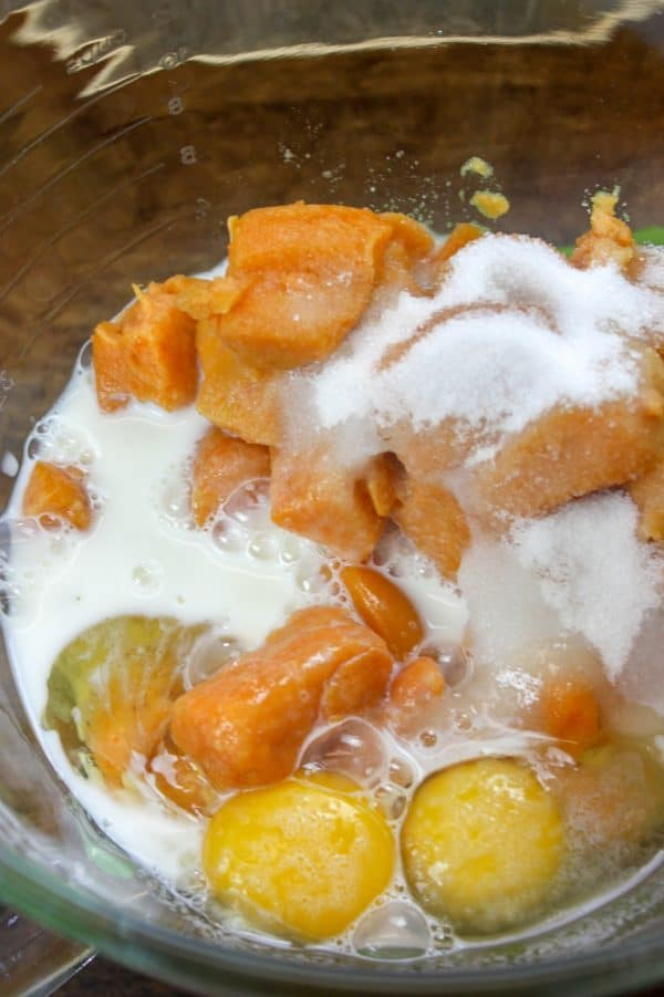 Picture of milk, sugar, eggs, and yams in a bowl
