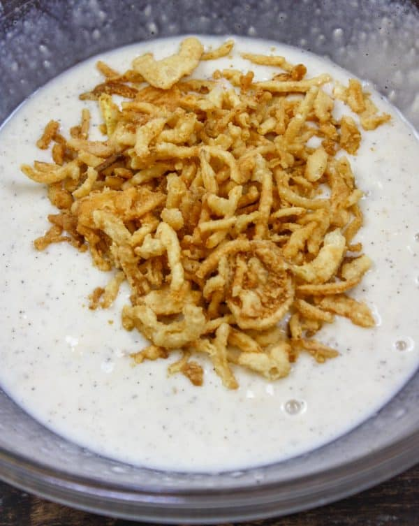 Picture of crispy fried onions on top of mushroom soup