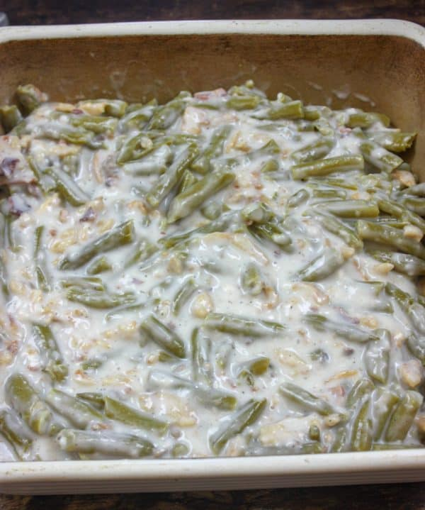 Picture of green bean casserole in a casserole dish.