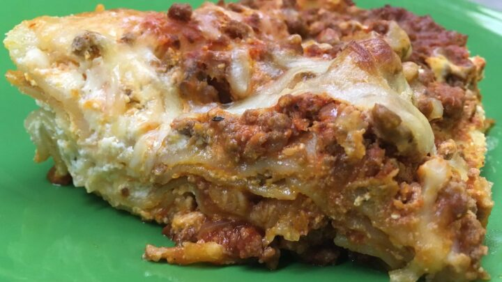If you're looking for a delicious meal that will feed and fill up your family, try this cheap hearty beef homemade beef lasagna.