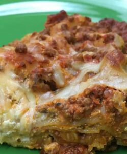 Easy lasagna on a green plate.