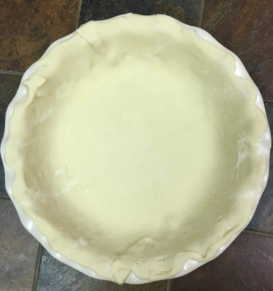 Pie crust rolled out in a deep dish pie pan.