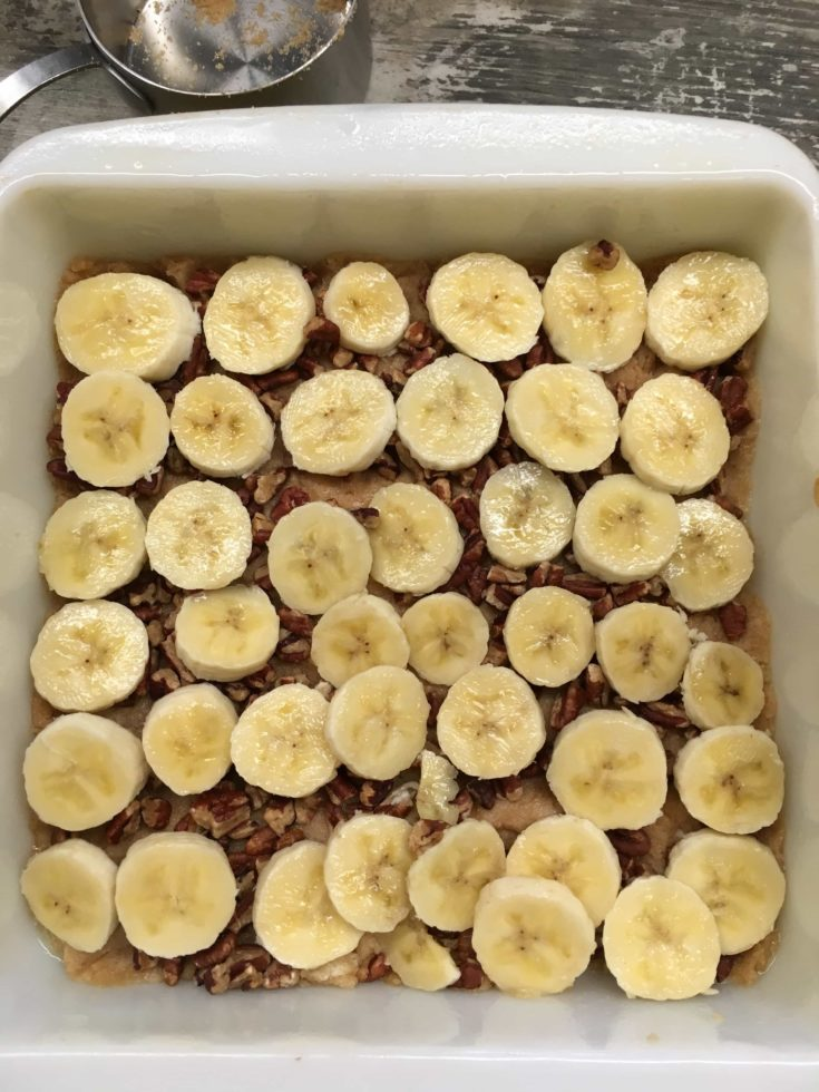 Bananas, brown sugar, and pecans in a casserole dish.
