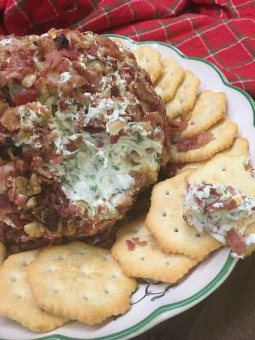 Cheese balls are such a hit during the holidays, and this easy Holiday Bacon Ranch and Walnut Cheese ball is a classic holiday appetizer. The cheese ball is the perfect food to bring to any party. If I am short on time, I use pre-made real bacon to make it quick and get it ready to eat. #easy #recipes #ranch #bacon #best #bacon