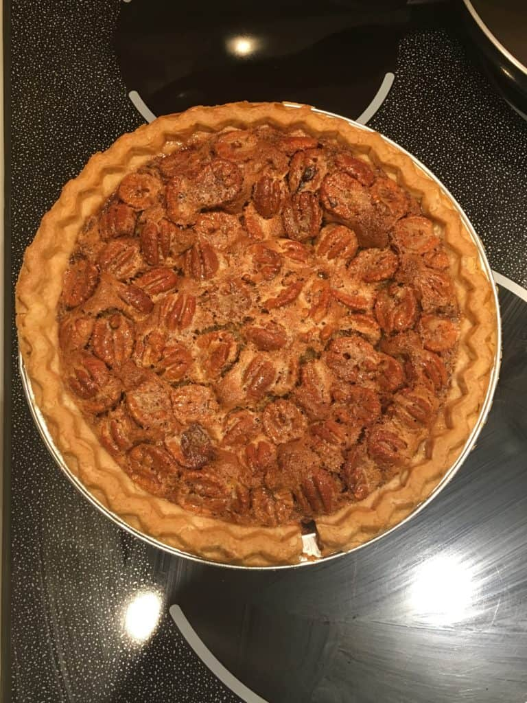 Baked pecan pie sitting on a stovetop