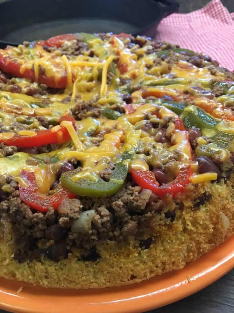 Easy Chili Cornbread Skillet is a tasty meal that won't break the bank, but will leave everyone full and satisfied. The chili cornbread skillet is a great meal to fix for tailgating parties, a quick supper, or to freeze and thaw out later when you're in a hurry. If you're watching your waistline, you can use lean ground beef, or ground turkey.