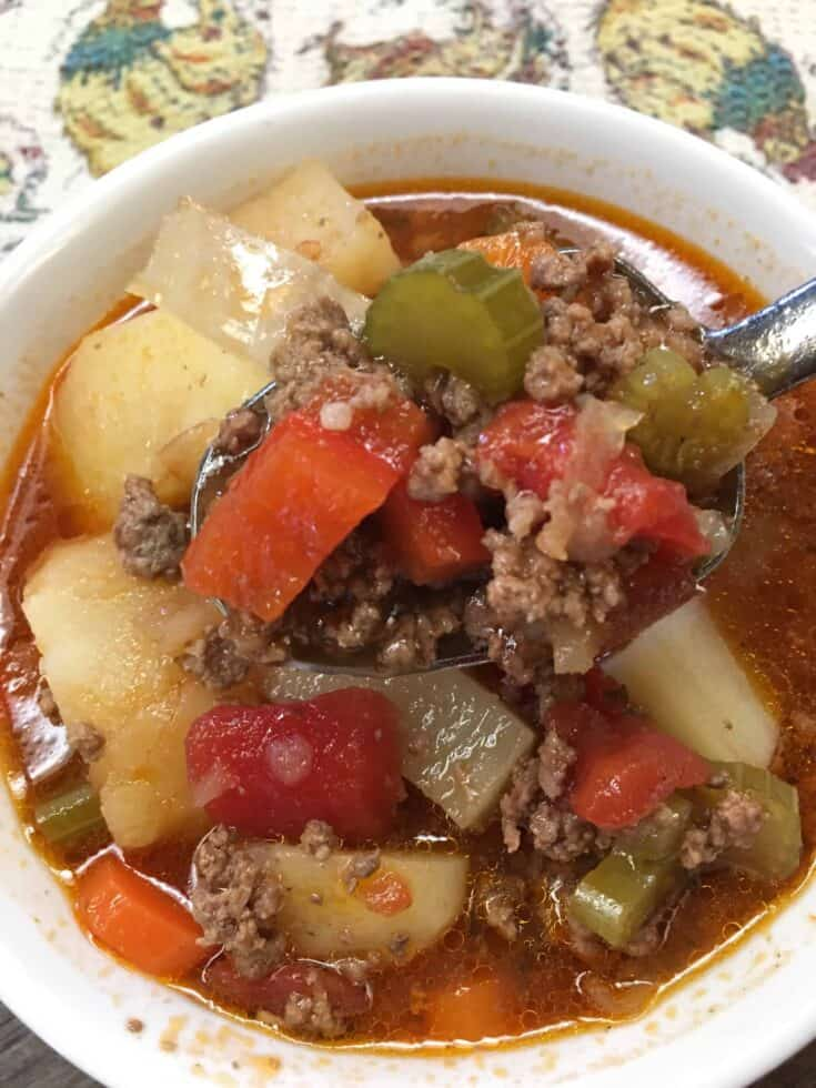Ground beef and veggies cooked and in a bowl for soup