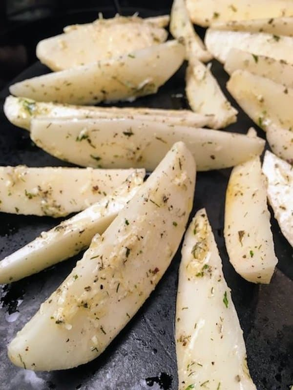 Oven Baked Potato Wedges recipe is a delicious and easy side dish to fix. The seasoned oven baked potato wedges recipe is perfect for supper or as an appetizer for football games, parties, and as a snack.