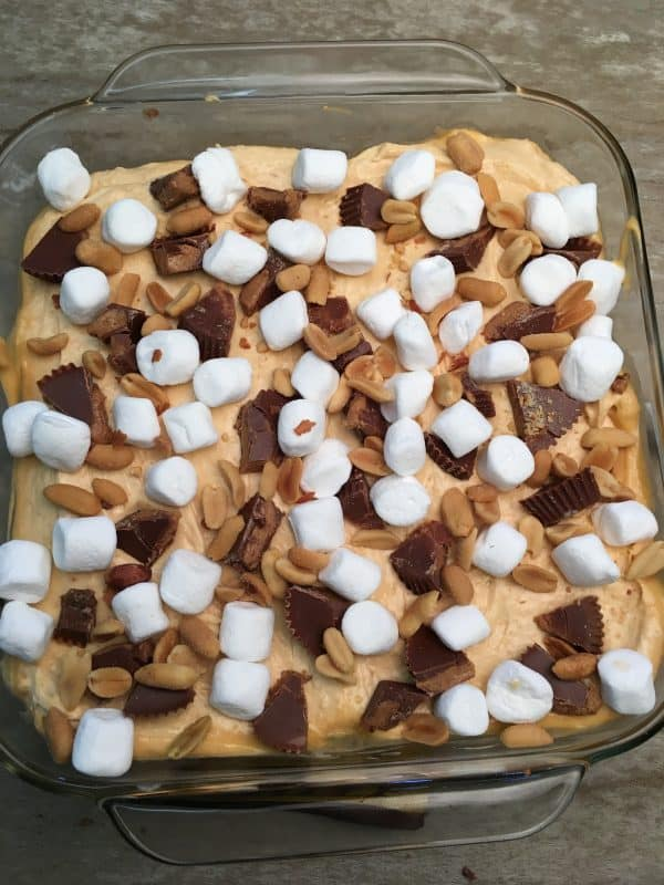 Reese's Peanut Butter Pudding Dessert is the perfect recipe for any gathering. The peanut butter cup dessert is filled with pudding, marshmallows, peanuts, graham crackers, and chocolate syrup. The recipe is a delicious treat that everyone will love.