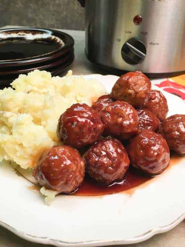 Easy Crock Pot Meatball Recipe is made up of frozen meatballs, barbecue and grape jelly. The dish makes a great dinner or an appetizer for church or a party, and is easy to make.