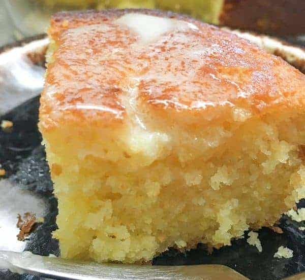 Cornbread with melted butter on a brown plate