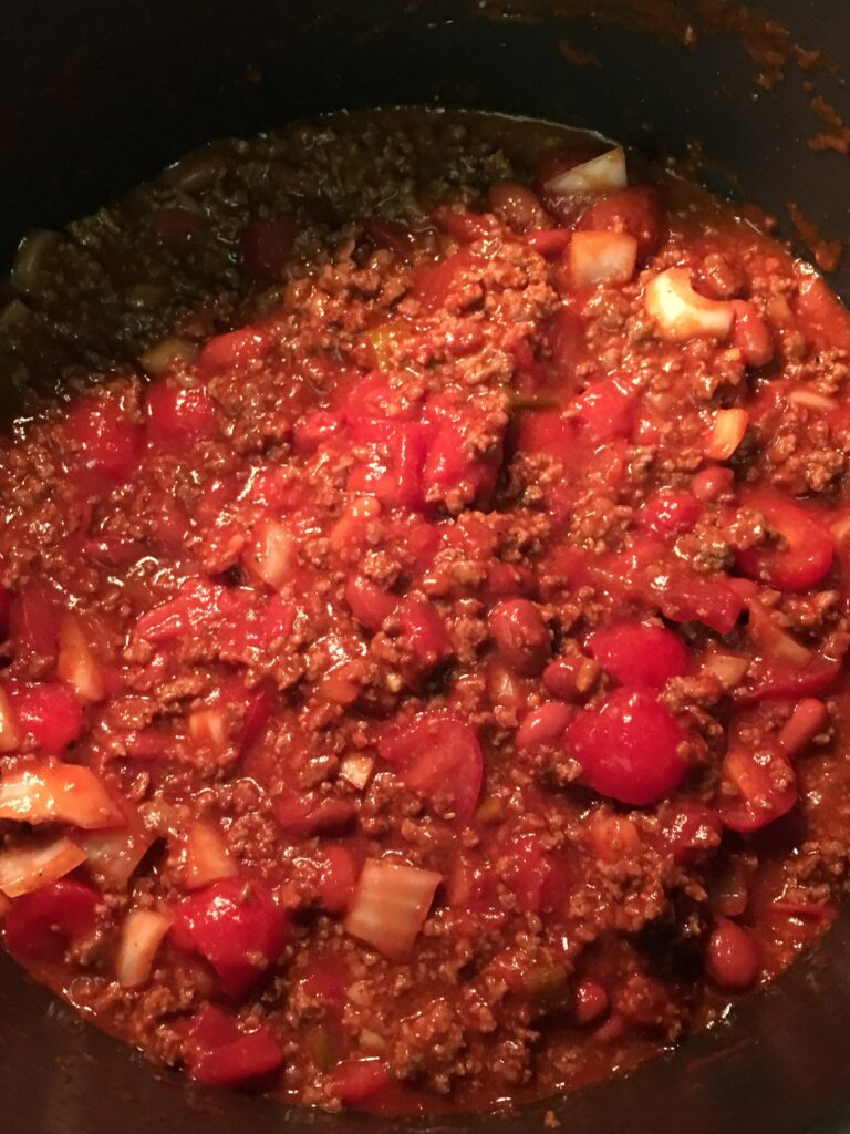 Simmering chili in a saucepan.
