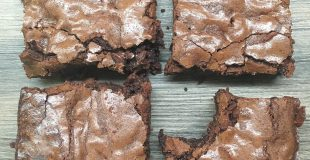 Easy homemade brownies with chocolate chips on a counter.