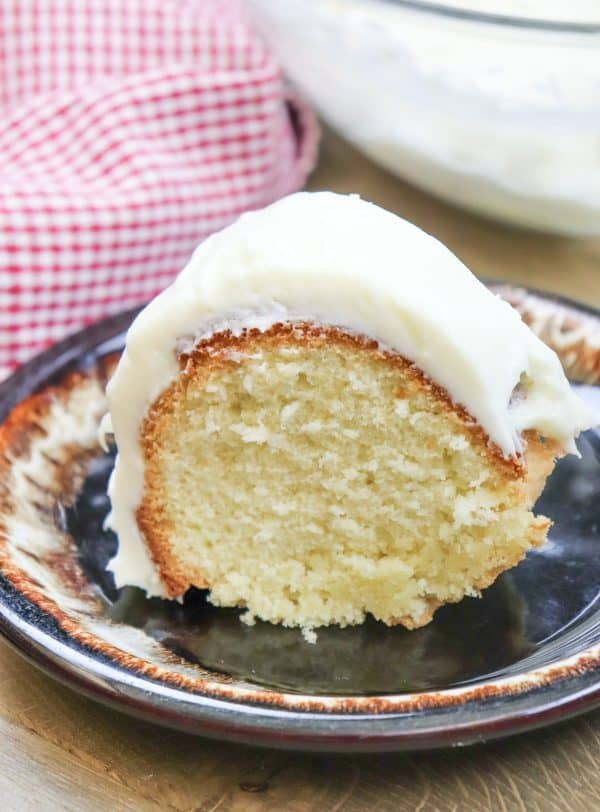 Picture of pound cake on a plate with cream cheese frosting
