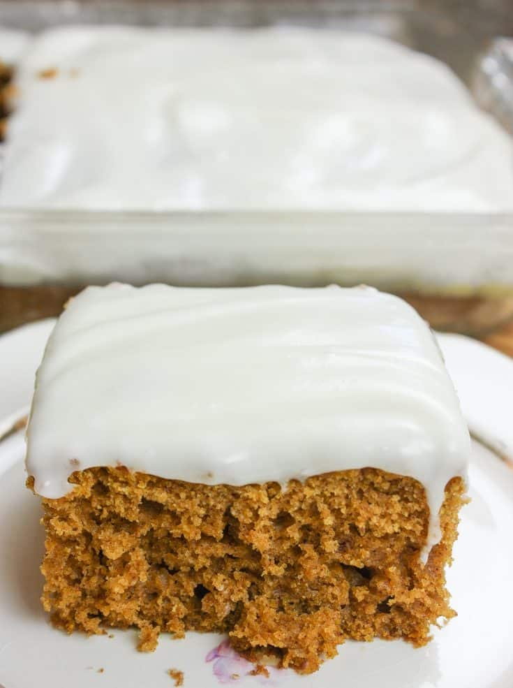 Easy pumpkin bars with cream cheese frosting is a wonderful fall dessert. The cake is a quick recipe that everyone will love during the winter holidays. The smells of cinnamon, nutmeg, ginger, and cloves will fill your kitchen with the warmth of the season. #easy #recipes #withcreamcheesefrosting #fromscratch #halloween #mix #moist