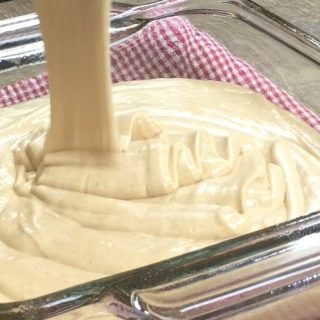 Picture of peanut butter fudge being poured into a glass dish