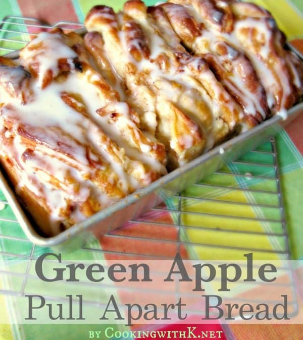 Picture of pull apart apple bread on a colorful tablecloth