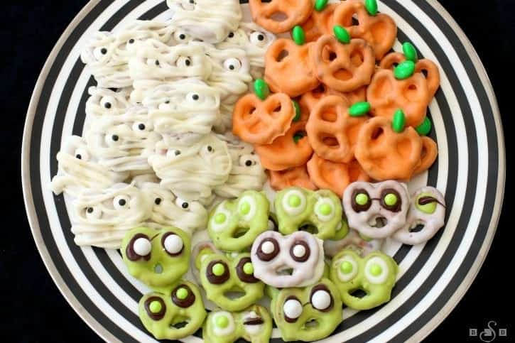 Picture of pretzels dipped in chocolate and looking like Halloween treats!
