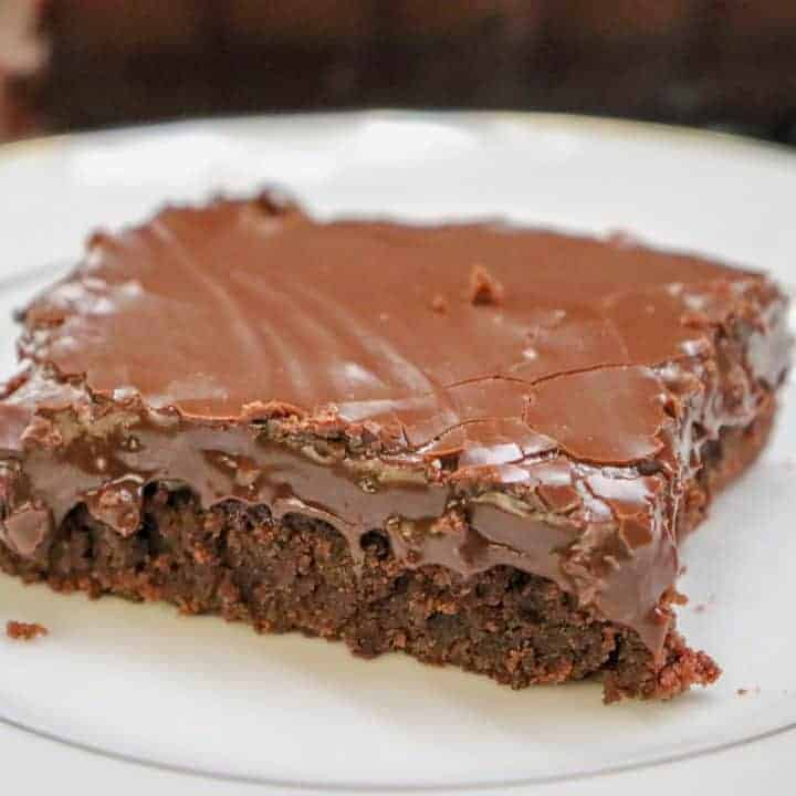 Picture of a brownie with fudge frosting on top.