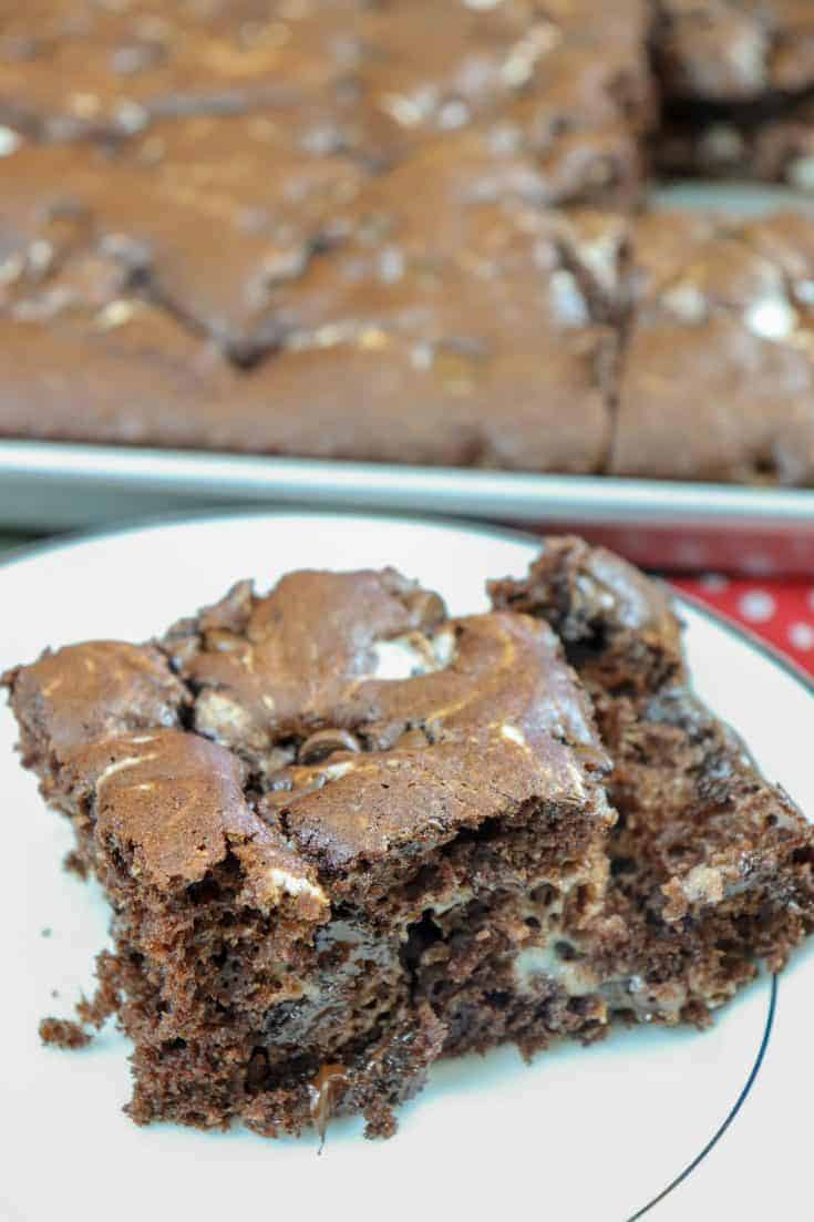 This Chocolate Marble Cake Bar Recipe is so easy and quick to make. The kids loved it and asked for more than one serving. It only takes about 10 minutes to prepare and 30 minutes to bake. #marblecakebars #chocolatecake #