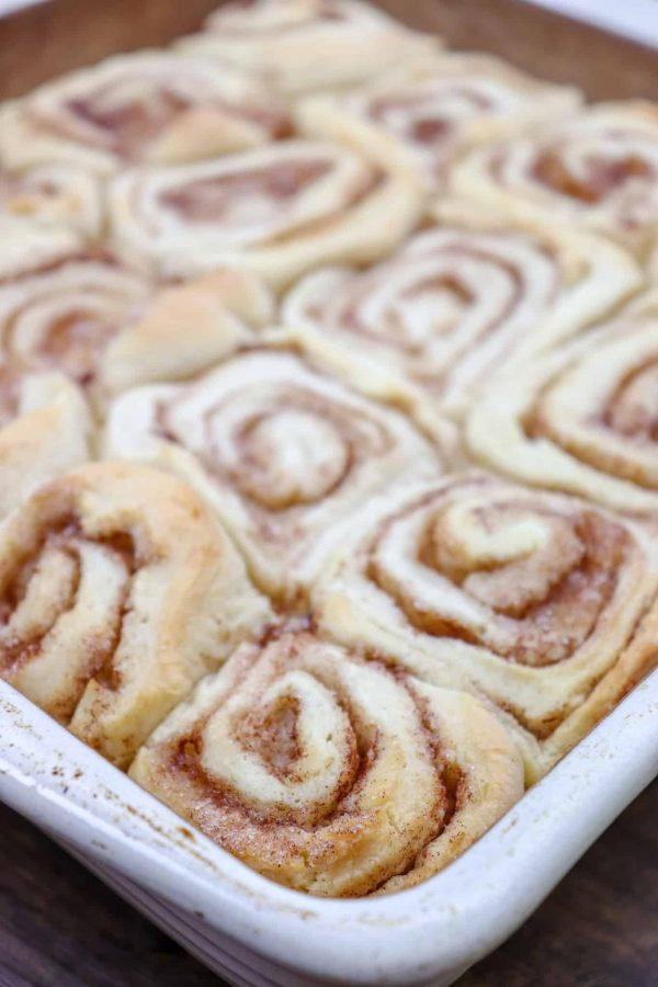 Picture of baked cinnamon rolls in a casserole dish.