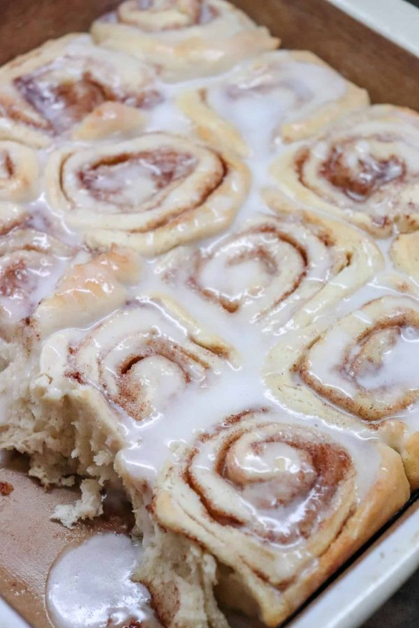 Picture of cinnamon rolls in a baking dish with icing.