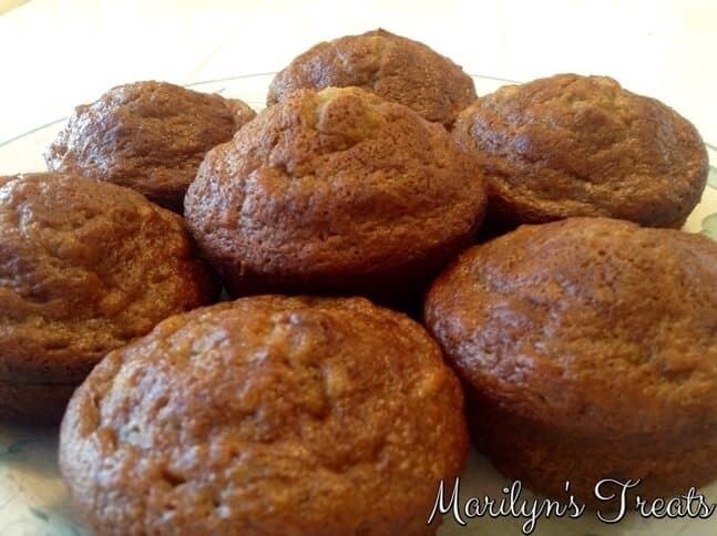 Picture of apple cinnamon muffins stacked on top of each other