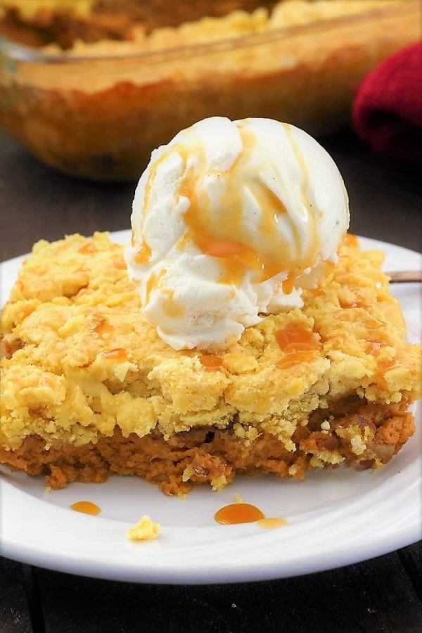Picture of pumpkin pie cake with a scoop of ice cream on top