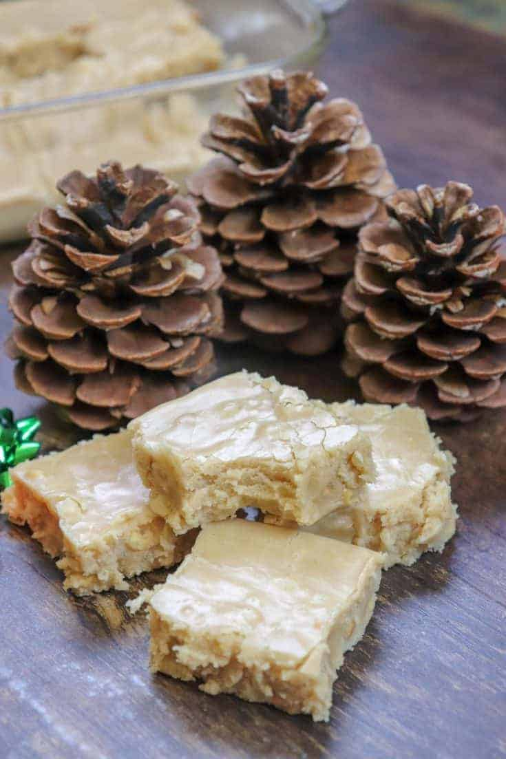Crunchy Peanut Butter Fudge is a traditional fudge recipe. It's easy to make and pretty addictive. This is one of the best fudge recipes you will find. The peanut butter crunch is surrounded by creamy soft fudge and is sure to be a hit around the holidays or any time of year. #easy #recipe #minimarshmallows #Homemade