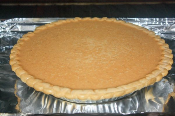 Picture of pumpkin pie in the oven.