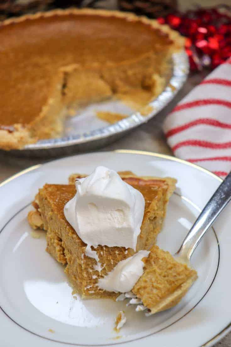This is the best pumpkin pie recipe. It's the classic easy pumpkin pie recipe that you can mix together in about five minutes. It takes about an hour to bake and a couple more hours to rest. The pie is filled with pumpkin, evaporated milk, and the best fall seasonings including cinnamon, nutmeg, ginger, and cloves. #fromscratch #easy #recipe #homemade #pumpkinpie