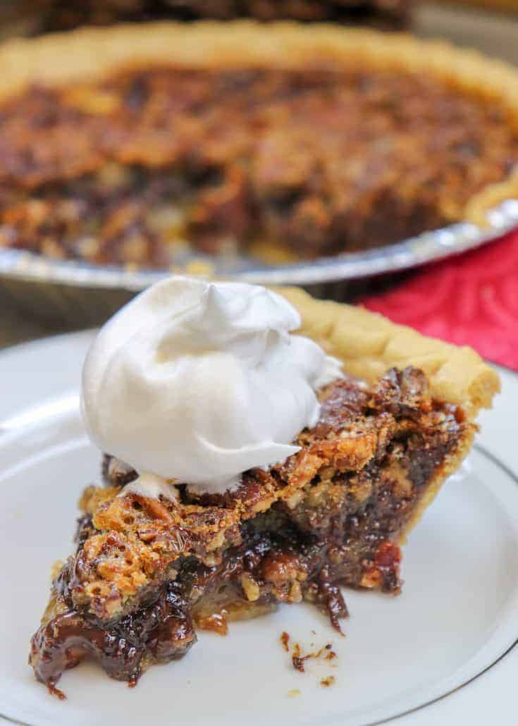 Chocolate Pecan Pie is a delicious dessert that combines the classic pecan pie recipe with a ribbon of chocolate. The easy southern pecan pie recipe takes about 10 minutes to make and less than an hour to bake. You'll love this Thanksgiving and Christmas holiday dessert. #easy #recipes #southern #best