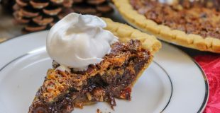 Picture of pecan pie with whipped cream.