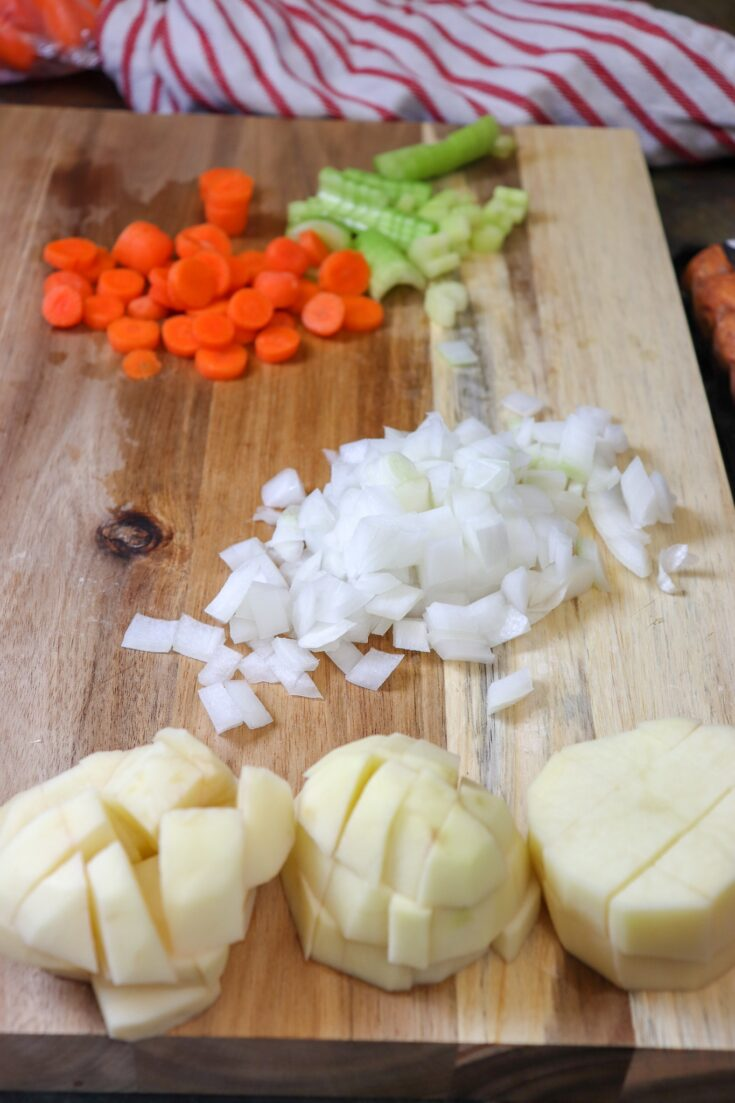 Picture of vegetables cut up on a wooden cutting board