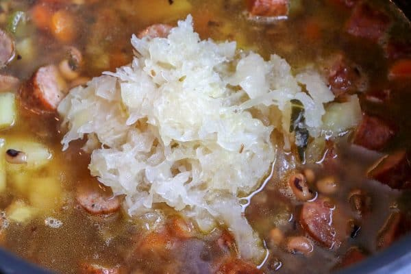 Picture of sauerkraut in soup in a large saucepan