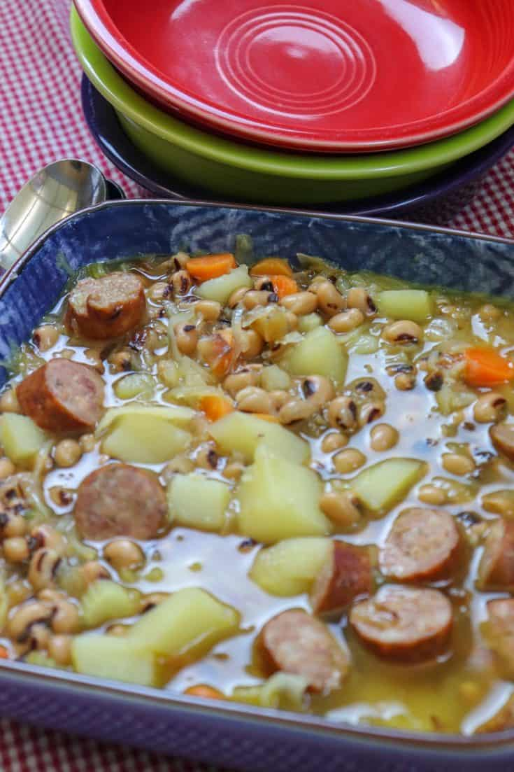 Black-Eyed Pea Soup with Sausage is a delicious meal for the entire family. This vegetable soup with sausage and sauerkraut is filled with a variety flavors that will burst in your mouth. Everyone will love this filling and hearty meal. #recipes #healthy #potato #vegetable