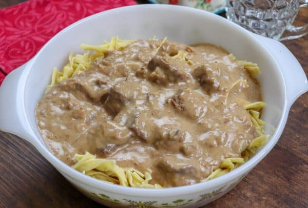 Picture of beef and noodles in a casserole dish.