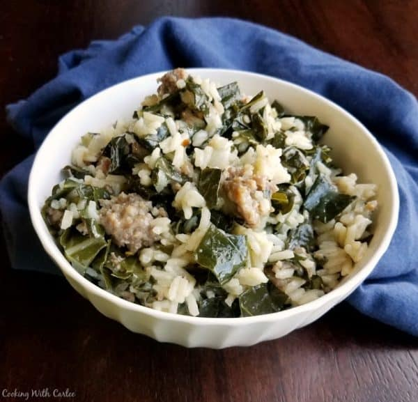 Bowl of collards with rice and Italian sausage