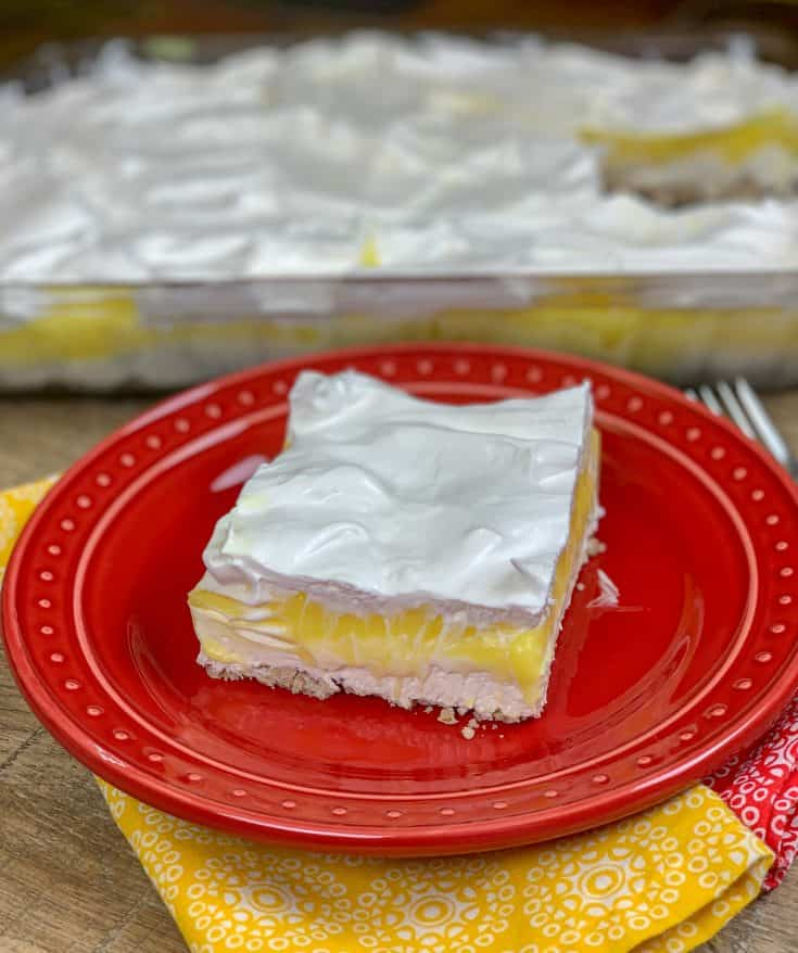 This lemon lush recipe is super easy to make and it tastes amazing. The combination of crunchy and creamy makes this refreshing citrus dessert a fun treat any time of year. #nobake #fromscratch #dessert #easy #recipe