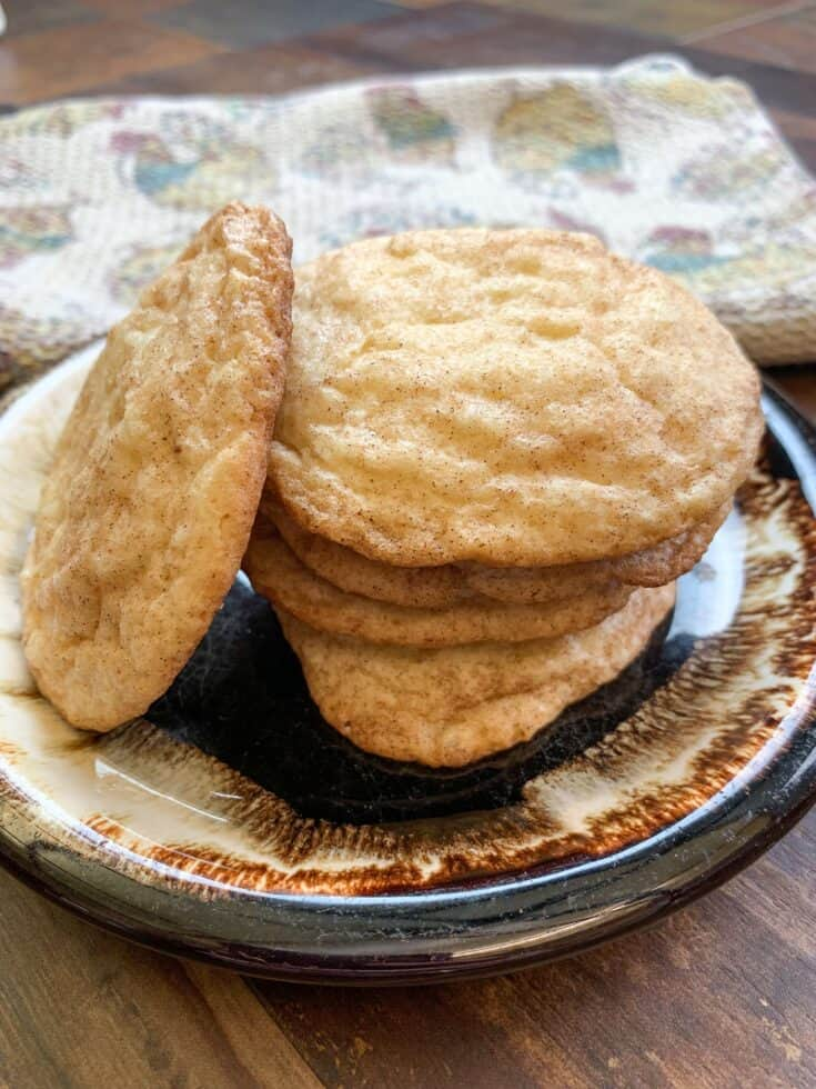 Snickerdoodle cookies are an easy recipe to make and you most likely already have the ingredients in the house. The cinnamon and sugar Snickerdoodle cookie recipe is a sweet treat for after school, classroom parties, Christmas gifts, or for making with the kids. #cookies #withoutcreamoftartar #recipe #soft #easy #chewy #desserts