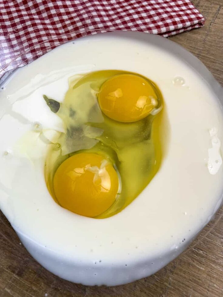 Eggs and buttermilk in a glass bowl