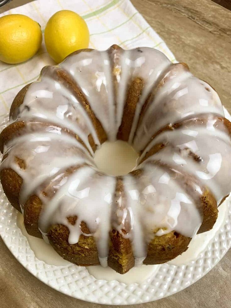 Lemon blueberry cake on a plate with glaze