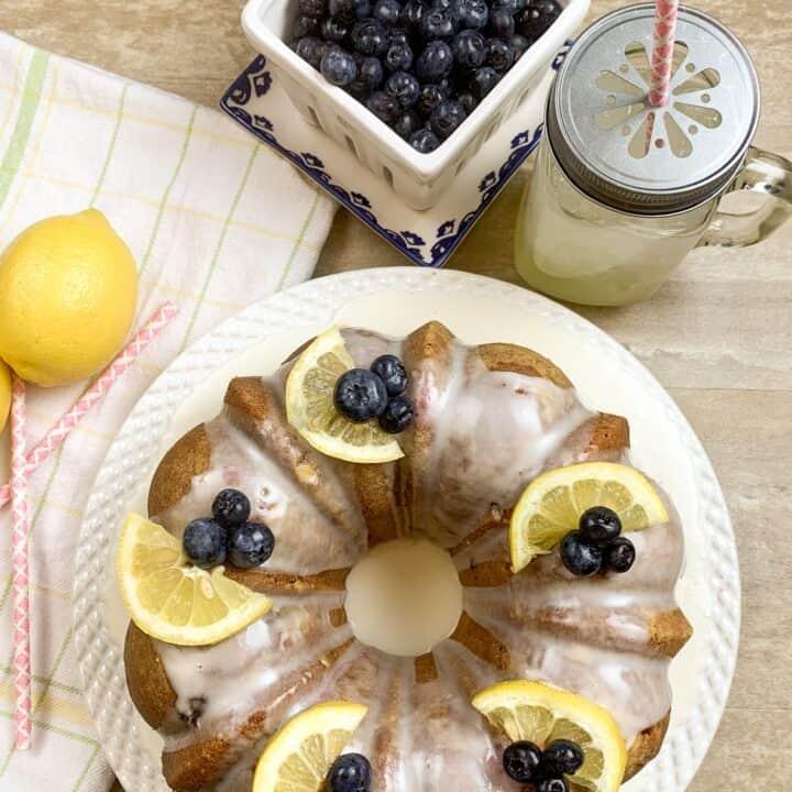 Lemon blueberry cake with lemonade, blueberries, and a lemon