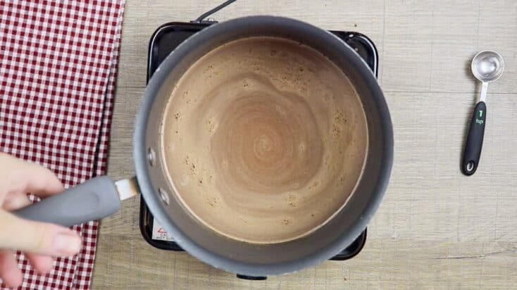 Chocolate cake ingredients in a saucepan