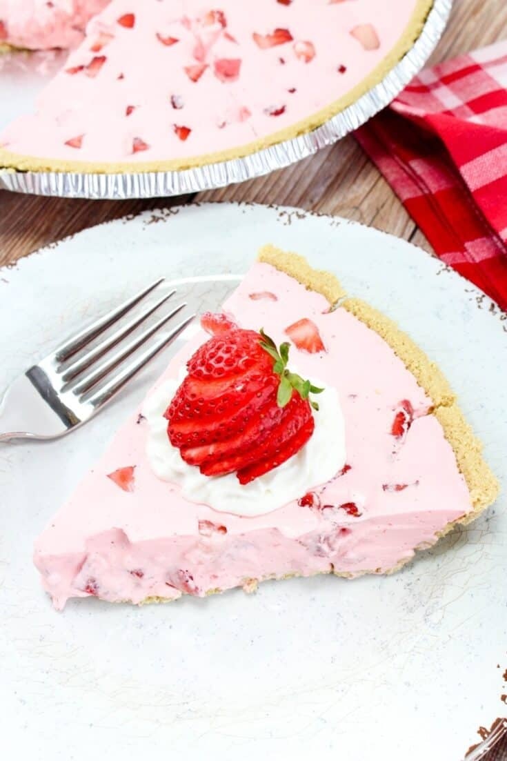 Strawberry pie on a white plate with a fork