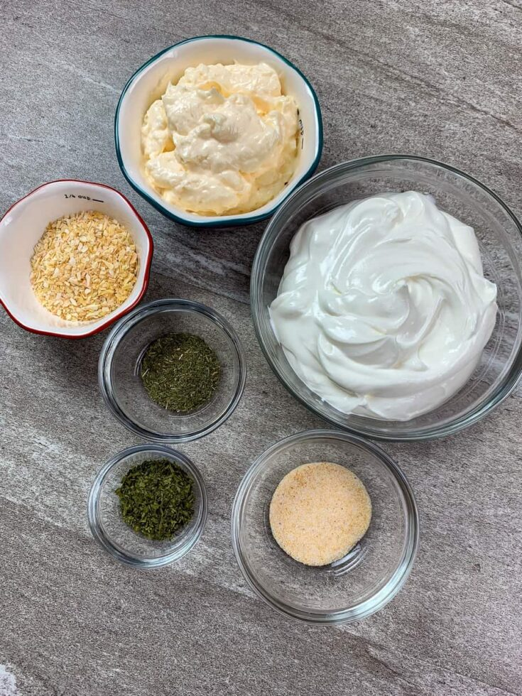 Six ingredients in bowls for sour cream dip