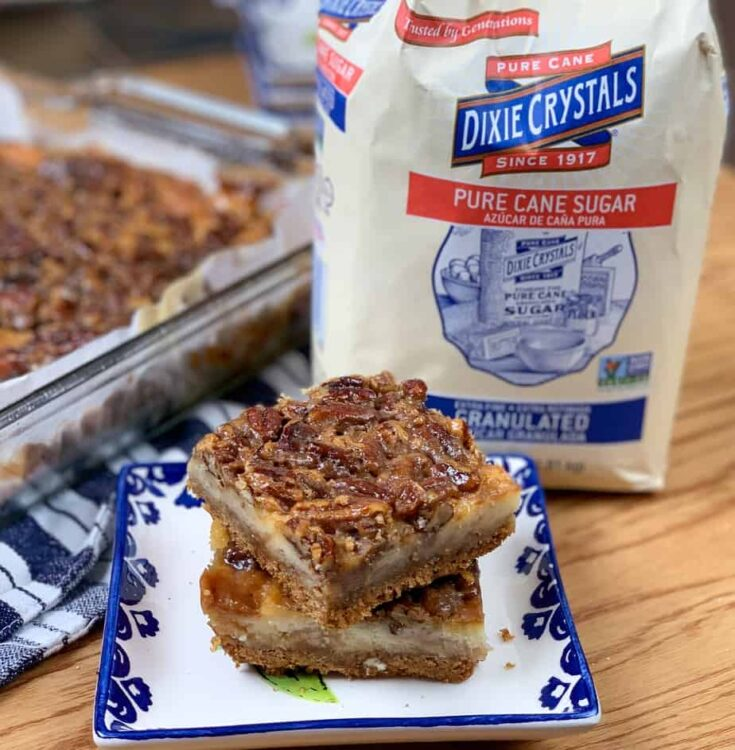 Pecan pie bars with a bag of Dixie Crystals sugar on the counter