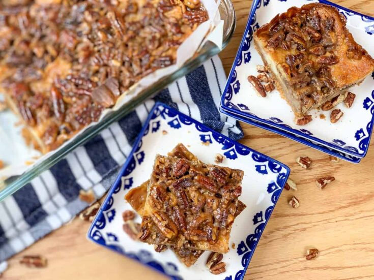 Pecan pie cheesecake bars on plates
